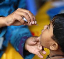 A girl receives a polio vaccine during the Measles-Rubella Vaccination Campaign at the Kandapara brothel in Tangail on 1 February 2014.  Dhaka, Saturday, 25 January 2014: For the first time Bangladesh today launched its largest ever Measles-Rubella (MR) campaign aiming to reach 52 million children aged nine months to under 15 years to protect them against these infectious diseases. Organized by the Government of Bangladesh, this campaign is one of the biggest public health mobilization efforts in the country, engaging thousands of vaccinators and volunteers. The campaign will cover more than 170,000 schools and 150,000 immunization centers over a three week period (ending 13 February 2014) with a special attention on children living on the streets and other high-risk populations.Plans are underway to vaccinate children living on the streets and other high-risk populations in urban areas who may not attend school or go to community vaccination sites. In the urban areas, teams have been assigned to cover railway stations, bus stations, river and sea terminals, parks and even footpaths. Special teams have also been mobilized to cover hard-to-reach areas such as haor (surrounded by water) and char (small islands) areas, large market places, rice mills, brick fields, brothels and places where working mothers live with their children. Routine measles vaccination coverage has reached 86 per cent  of children aged under one year in Bangladesh. This means that around one million children under one year remain susceptible to measles each year as they are left out or unable to develop immunity. Although in 2012, Bangladesh introduced measles second dose vaccine for children aged 15 months, older children still remained susceptible to the disease. These children need a second chance for survival. If a woman is infected with rubella, particularly before conception and during the first three months of pregnancy, there is 90 per cent chance of her passing the infection on to he