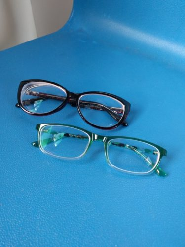 new glasses on blue schoolchair