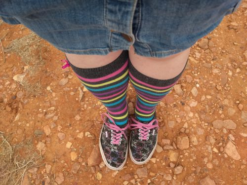 Rainbow socks and red dirt