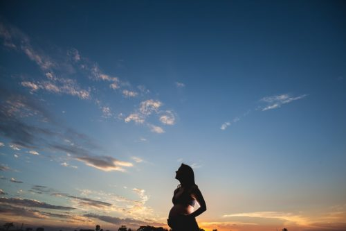 pregnant woman dawn clouds