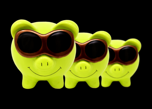 Green cartoon pigs with sunglasses on