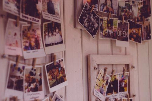 polaroid photos on a wall