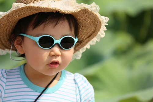 kid in hat and sunglasses